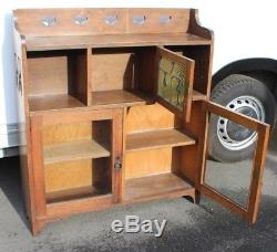 1920s Oak Arts and Craft style Bookcase with Stain Glass Door Feature