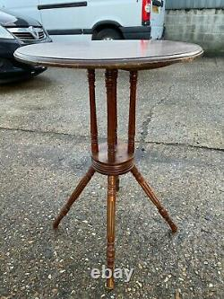 A Lovely Arts and Crafts Circular walnut Wine Table