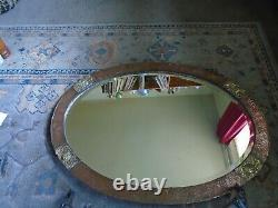 A Superb Large Arts and Crafts Copper and Brass Oval Mirror with Repousse Roses