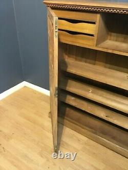 A beautiful quality Arts and Crafts stationery/bookcase cupboard in oak c1910