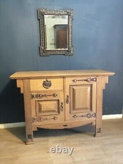 A fantastic small Arts and Crafts movement sideboard/cabinet in oak circa 1900