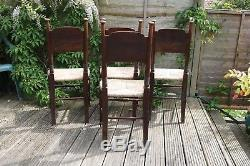 A set of four Arts and Crafts dining chairs by William Birch