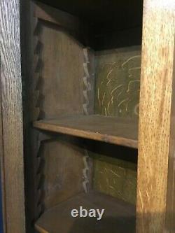 An Edwardian Arts and Crafts period dresser/cupboard in oak circa 1910