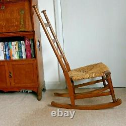 Antique Arts and Crafts Rocking Chair. Possibly by William Birch for Liberty