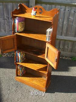 Antique Arts and Crafts bookcase with cupboard, pleasant golden colour finish