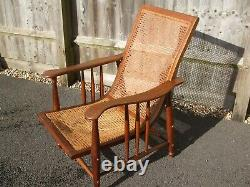 Antique oak easy chair, Shapland and Petter of Barnstaple, Arts & Crafts period