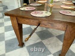 Antique oak wind out dining table in arts and crafts style, recently reburbished