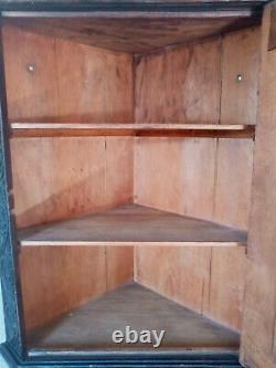 Art and crafts antique carved solid Oak hand carved corner cupboard