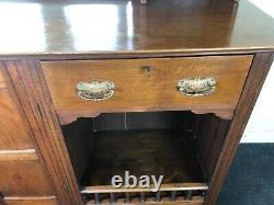 Arts and crafts oak sideboard with coloured glass cupboard doors