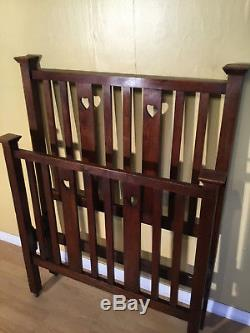 Arts and crafts red wallnut single childs bed in the manner of liberty