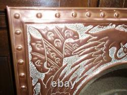Beautiful Arts and Crafts copper mirror with peacock design good condition