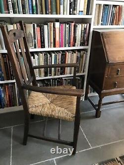 Edwardian Arts and Crafts elbow chair designed by William Birch of High Wycombe