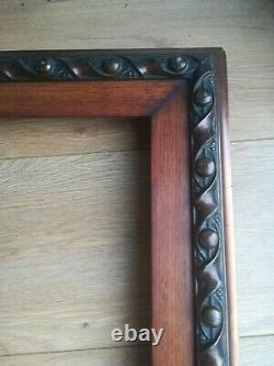 Large antique Arts & Crafts dark wood, gesso and copper gilt picture frame, 1884