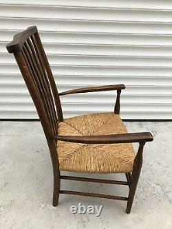 Liberty William Morris Arts and Crafts fireside Rushed arm chair