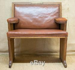 Oak and leather SETTLE Arts & Crafts Cotswold school, club chair, bench, c. 1910