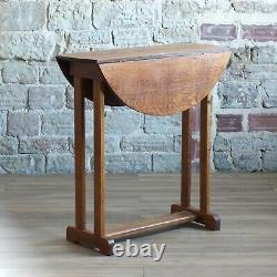 Oak arts and crafts twist top drop leaf table