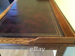 Oak three dwaw arts and crafts leather top writing table
