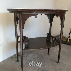 Oval Oak Arts And Crafts Occasional Table With A Lovely Gallery Shelf