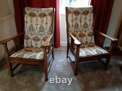 Pair of Arts and Crafts upholstered oak chairs
