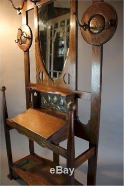 Shapland and Petter arts and crafts oak hallstand with copper roundels
