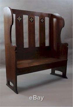 Wonderful Arts and crafts oak settle with pewter and ebony inlay c1900